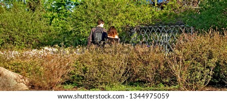 Young young man and girl together in the park in spring