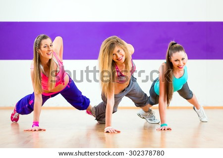 Young zumba women dancing modern group choreography in dance school