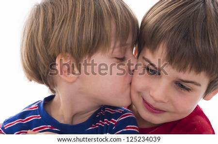 younger brother kisses the older