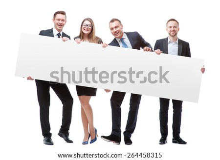 Your advertisement in good hands. Group of handsome young business people holding big blank with copy space. Isolated on white. #264458315