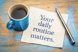 Your daily routine matters - handwriitng on napkin with a cup of coffee