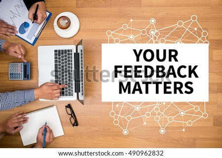 YOUR FEEDBACK MATTERS Business team hands at work with financial reports and a laptop #490962832