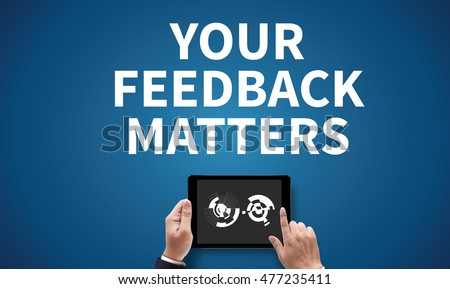 YOUR FEEDBACK MATTERS, on the tablet pc screen held by businessman hands - online, top view #477235411