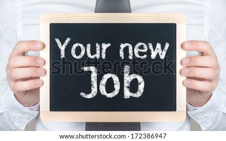 Your new Job handwritten on blackboard which holding man
