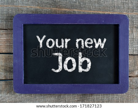 Your new Job written on blue framed chalkboard on wooden background