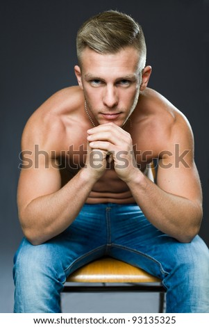 Your personal trainer, portrait of a very fit handsome young man.