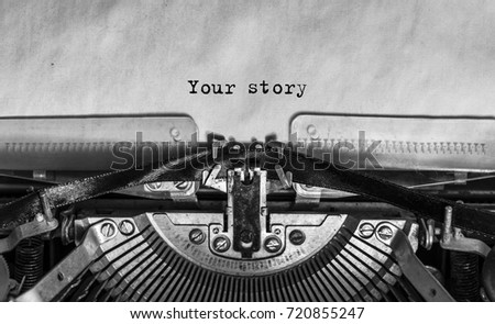 your story typed words on a Vintage Typewriter. Mechanisms closeup. Typing on old typewriter #720855247