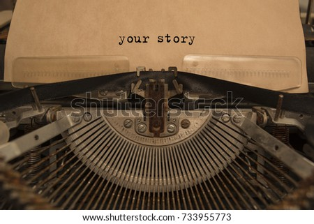 your story typed words on a Vintage Typewriter. Mechanisms closeup. Typing on old typewriter #733955773