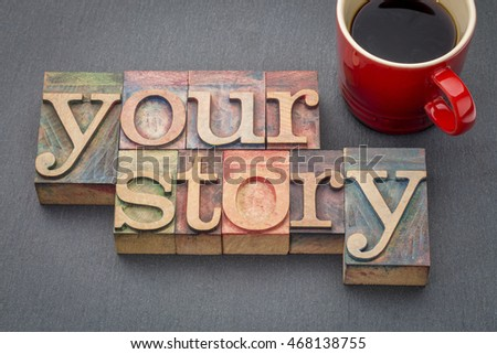 your story - word abstract in  letterpress wood type stained by color inks against a slate stone with a cup of coffee #468138755