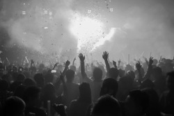 Youth clubs are fun, hands clapping, holds up the phone recording. DJ in clubs that have Music fun. Blurry night club DJ party people enjoy of music dancing sound .  Bangkok RCA Thailand. back white
