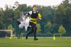 Youth Football Player Running with Parachute. Soccer Football Endurance Training. Speed or Sprint Testing. Professional Soccer Strength Test. Young Boy in Football Club Exercising on Training Venue