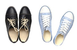 Youth sneakers from the 80s and classic female black shoes isolated on white background. Top view.