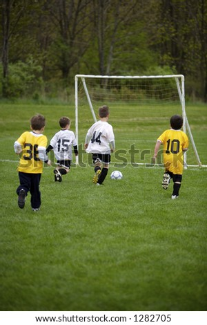 Youth Soccer Game.  White Team ready to Score