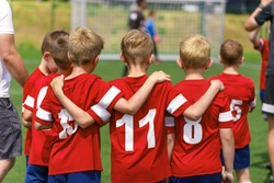 Youth Soccer Team Substitute Players. Boys Standing in a Row Huddling During Penalty Kicks. Football Tournament Competition for Kids