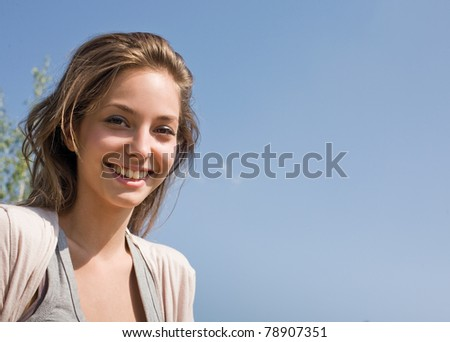 Youth, summer and beauty, outdoors sunlit portrait of a beautiful young brunette girl. - stock photo