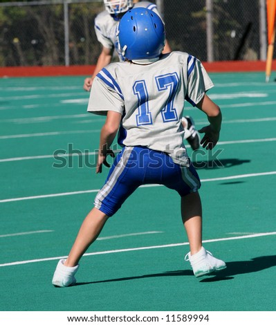 Youth Teen Football Player Ready to Catch ball during game 2