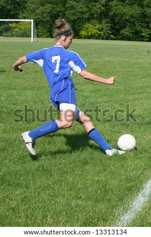 Youth Teen Soccer Player in Action on field during game.
