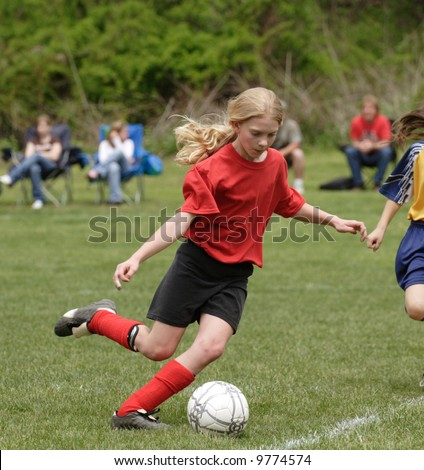 Youth Teen Soccer Player Kicking Ball on Field During Game 3 - stock photo