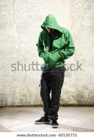 Youth with green hoodie and grunge background