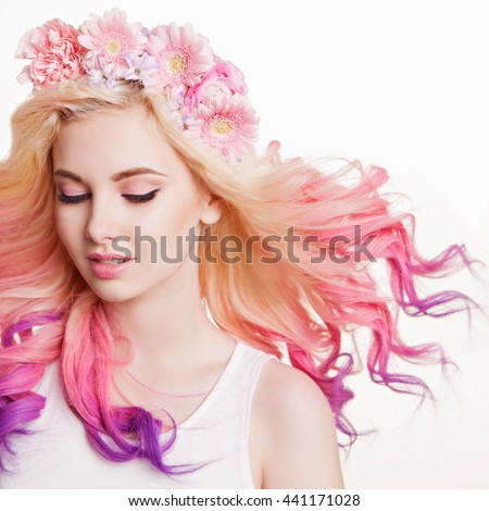 Youth women with curly colored hair and flowers. white and pink background. Beauty. Flying Hairs
