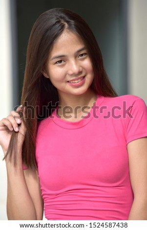 Youthful Minority Female With Long Hair