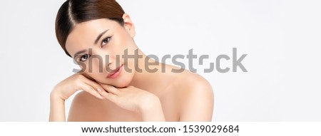 Youthful pretty Asian woman with hands touching face isolated on white banner background for beauty and skincare concepts