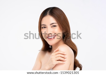 Youthful smiling Asian woman isolated on white background for beauty and skin care concepts
