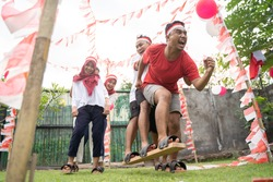 youths followed the bakiak race on the 17th of August Independence Day in Indonesia
