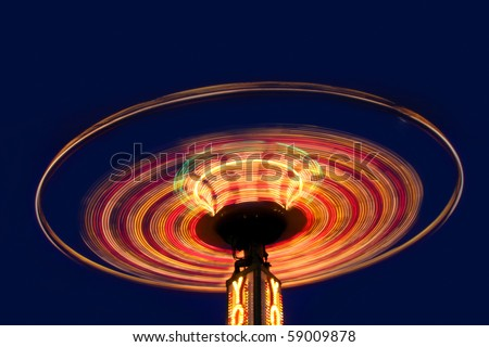Yoyo amusement ride in night time shot with long exposure