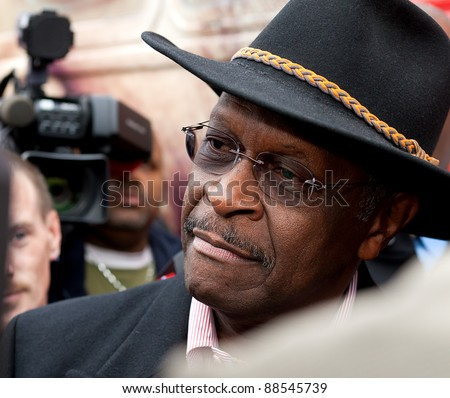 YPSILANTI, MI - NOVEMBER 10th: Presidential candidate Herman Cain listens to questions from supporters, November 10, 2011 in Ypsilanti, MI