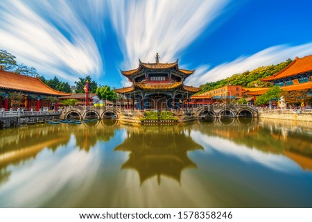 Yuantong Temple refletion with waterfront, Kunming capital city of Yunnan, China, travel and tourism,famous place and landmark, religion and traditional concept,Chinese language mean Yuantong Temple Foto stock ©