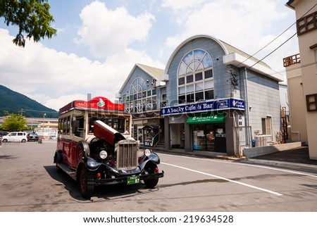 Yufuin,Oita,Japan - July 25, 2014 : The Classic car is in main street of Yufuin,Oita,Japan on July 25, 2014.Yufuin,Oita,Japan