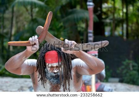 Yugambeh Aboriginal man holds boomerangs during Aboriginal culture show in Queensland, Australia.