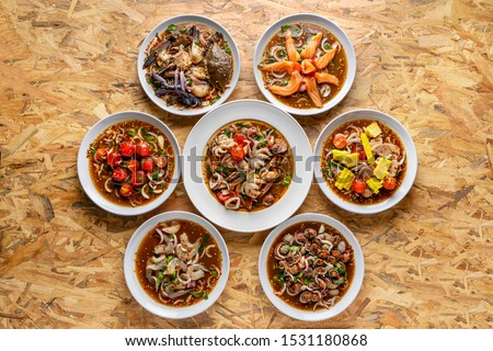 Yum, Spicy salad, spicy Thai food, mixed on the table,Collection set of Spicy salad (Yum Thai style) Traditional spicy -hot seafood, egg Thai food. Thai cuisine delicious food popular