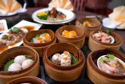 yumcha,The Arrangment of various dim sum in bamboo steamer with chinese bun , pao , bao zi , steamed dumpling  etc