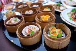 yumcha, various dim sum in bamboo steamer in chinese restaurant