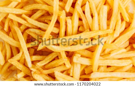 Yummy french fries as background. Flat lay, top view