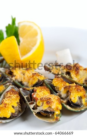 Yummy mussels under cheese and lemon