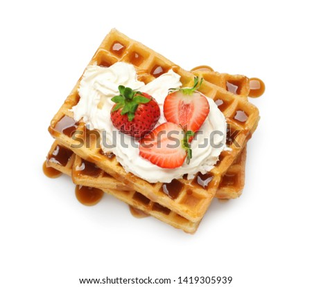 Yummy waffles with whipped cream, strawberries and caramel syrup on white background, top view Stock fotó ©