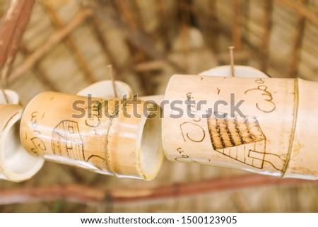 Yumurí valley, Matanzas / Cuba - May 13 2014 : Cuban wood mug souvenirs on sale to tourists at roadside grass shack market #1500123905