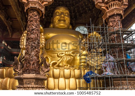 Yuntian Cultural City, Yulin China, featuring an extravagant collection of Buddhism relics and a giant big belly buddha statue, reiterating the buddhist teaching on tolerance and acceptance. #1005485752