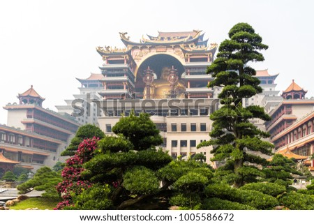 Yuntian Cultural City, Yulin China, featuring an extravagant collection of Buddhism relics and a giant big belly buddha statue, reiterating the buddhist teaching on tolerance and acceptance. #1005586672