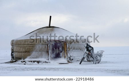 yurt in the snow with motorcycle mongolia