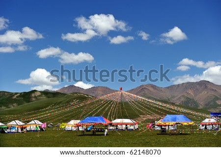 yurt mongols with colored  ribbon in grasslands at Qinghai