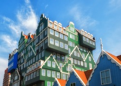 Zaandam, The Netherlands, May 19, 2019: The famous Inntel hotel in the center of Zaandam with on the outside the different facades that were known in historical Zaandam