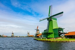 Zaanse Schans is a famous Dutch village with windmills, Agricultural historical landscape. Tourism. Popular Holland, Netherlands, Europe.