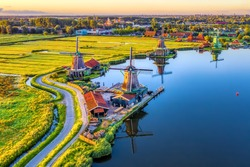 Zaanse Schans windmills park and fields landscape in Zaandam near Amsterdam, North Holland, Netherlands, aerial view in sunrise light