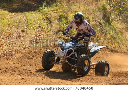"ZABREH, CZECH REPUBLIC - OCTOBER 30. Unidentified racer rides a quad motorbike in the ""Zabrezky Motocross"" on October 30, 2010 in the town of Zabreh, Czech Republic. - stock photo"