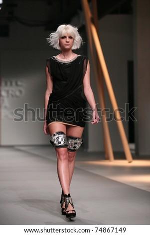 ZAGREB, CROATIA - APRIL 2: Fashion model wears clothes made by Matija Vuica in 'Croaporter' show, April 2, 2011 in Zagreb, Croatia.