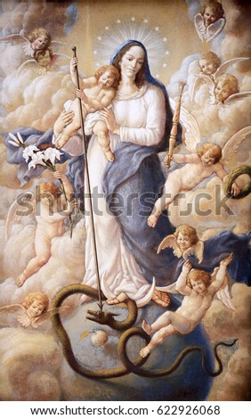 ZAGREB, CROATIA - APRIL12: Virgin Mary with baby Jesus and angels, fresco painting on house fasade in Zagreb, Croatia on April 12, 2015.